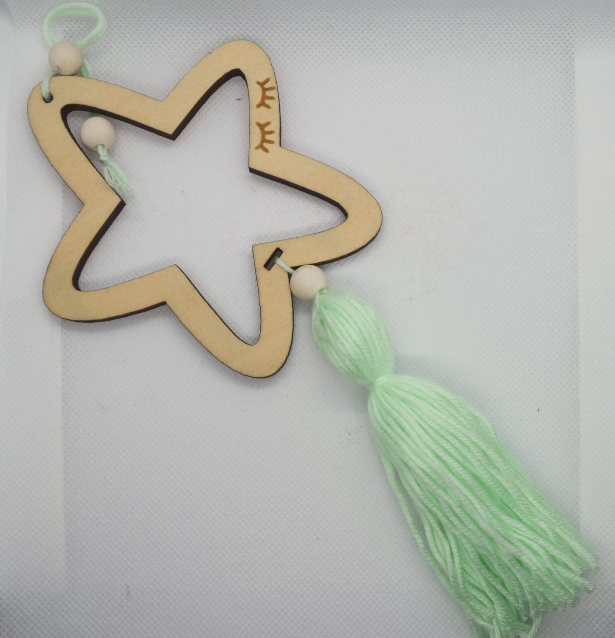 Gwiazdka z zielonym pomponem